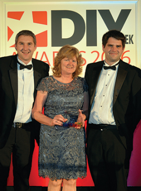 L-R: Chris, Vivienne and Jeff Abbott pick up their award for Hardware Retailer of the Year