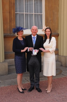 Colin Squire with his daughters Sarah and Elizabeth at Buckingham Palace
