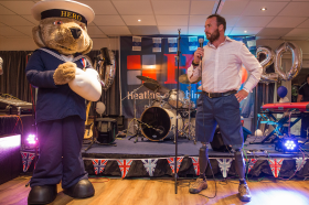 Help for Heroes mascot with Paralympian long jumper and former Royal Engineer Luke Sinnott address guests at the Polypipe Regatta celebration evening. Photo credit: Sarah Bardsley Photography