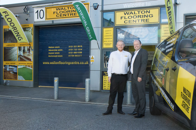 (L-R)Walton Flooring Centre managing director James Harper with Paul Trickett of Bathgate Business Finance outside Walton Flooring Centre headquarters in Huyton.