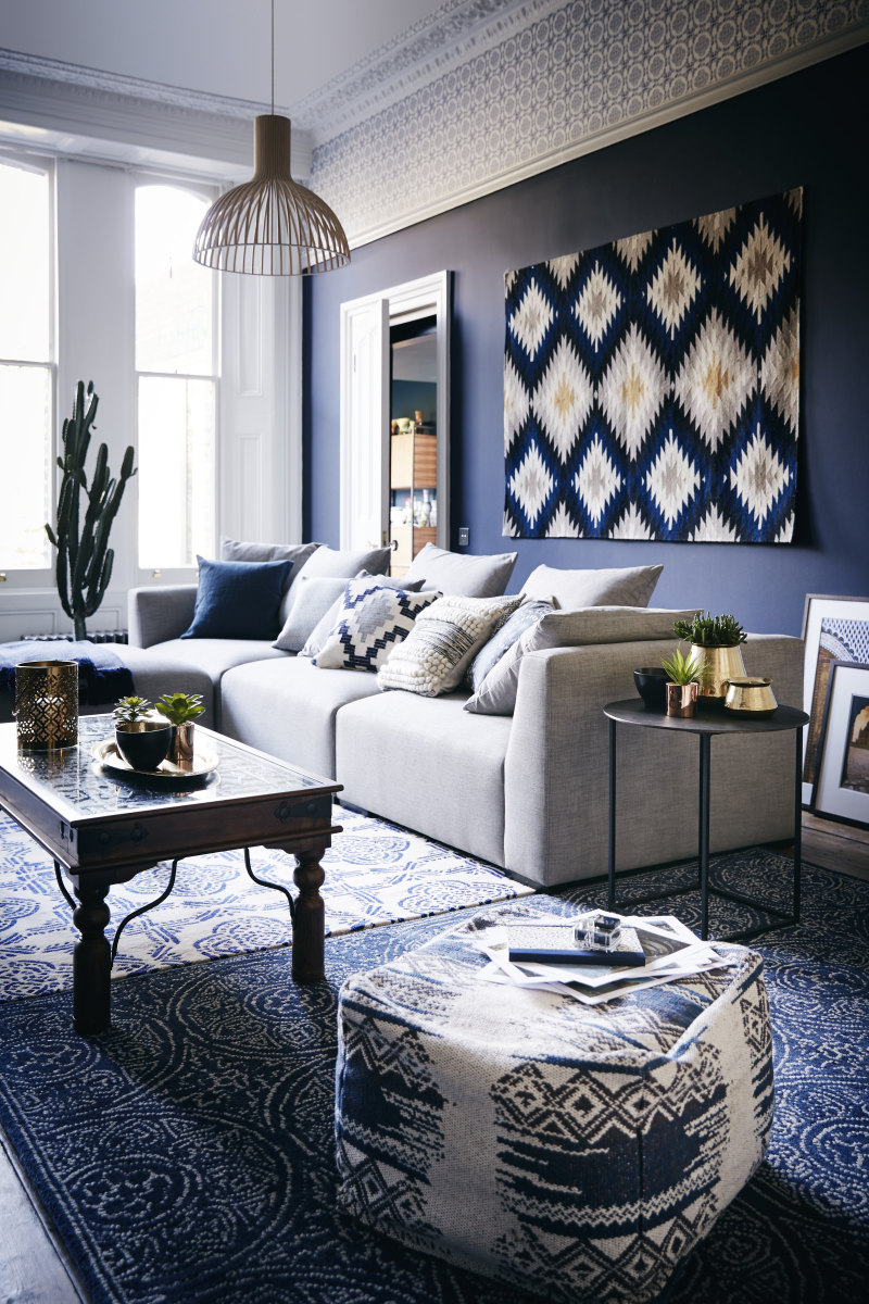 Despite a dip in home sales this week, John Lewis says consumers are still buying decorative accessories, such as rugs, art and mirrors to spruce up their homes