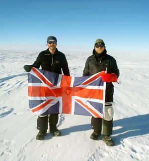 Andrew Carnie (left) flying the flag as he reaches the South Pole