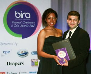 Pritesh is presented with his award BHF Young Retailer of the Yeaby Akzo Nobel's Synnita Cunningham