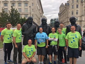 John Collett (second from left) with his team at the Liverpool Nightrider event