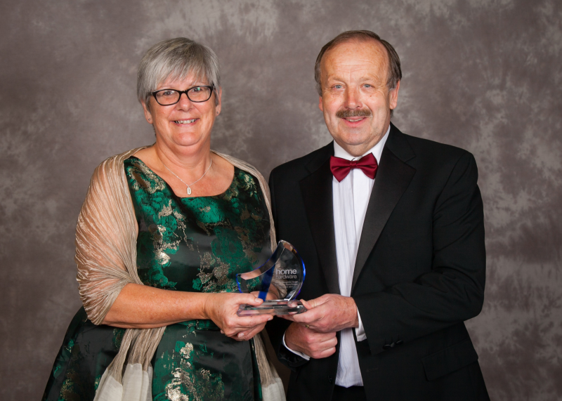 Fiona Robson being presented with her award by Home Hardware chairman David Adams