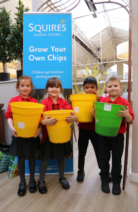 Students from Lea Infant School with their pot of potatoes