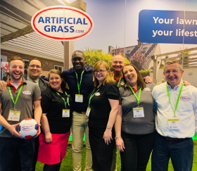 NMBS Show 2019 - Emma (third from left) and Kerry (second from right) with the ArtificialGrass.com team and Emile Heskey (fourth from left)