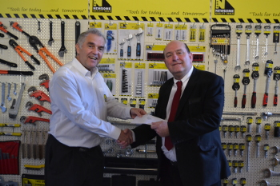 Martin Tonkin was awarded a special gift to commemorate his years of service with Newsome Tools
